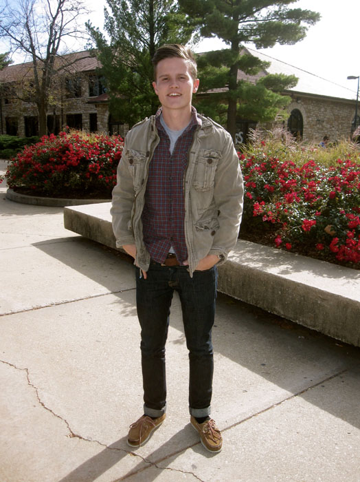 "Junior philosophy major Benjamin Martin from Olathe channels his ""New England professor and blue collared worker"" look to display his love for the 50′s era. Major fashion props to Martin for finishing his look with an appropriate style haircut as well. Check out the article in the Daily Kansan!"