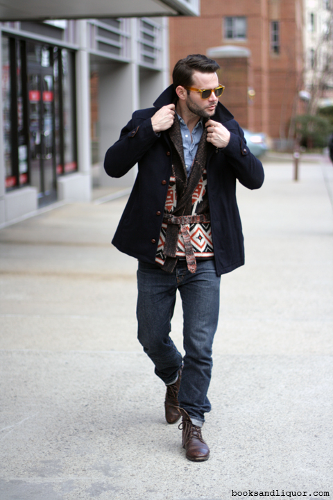 Jordan, Harvard Student - wears a short peacoat over a geometric shawl collar sweater, blue fitted jeans and brown boots.