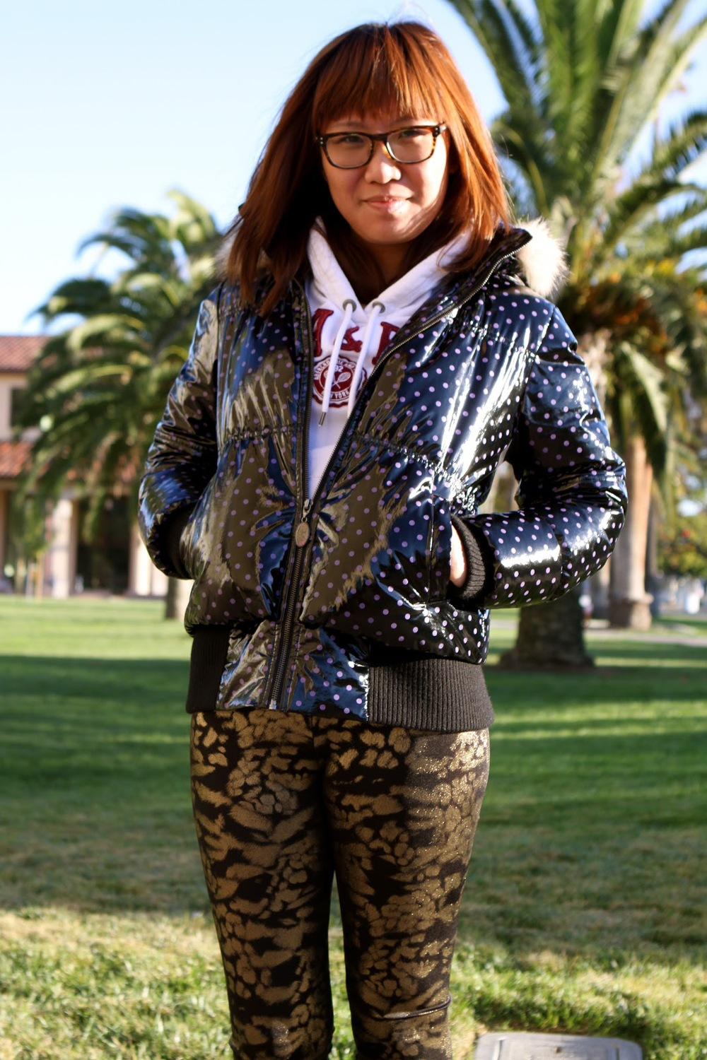Ikea, a Santa Clara University student wears a polka dotted faux leather puffer jacket over a hoodie paired with a pair of silk print slim pants