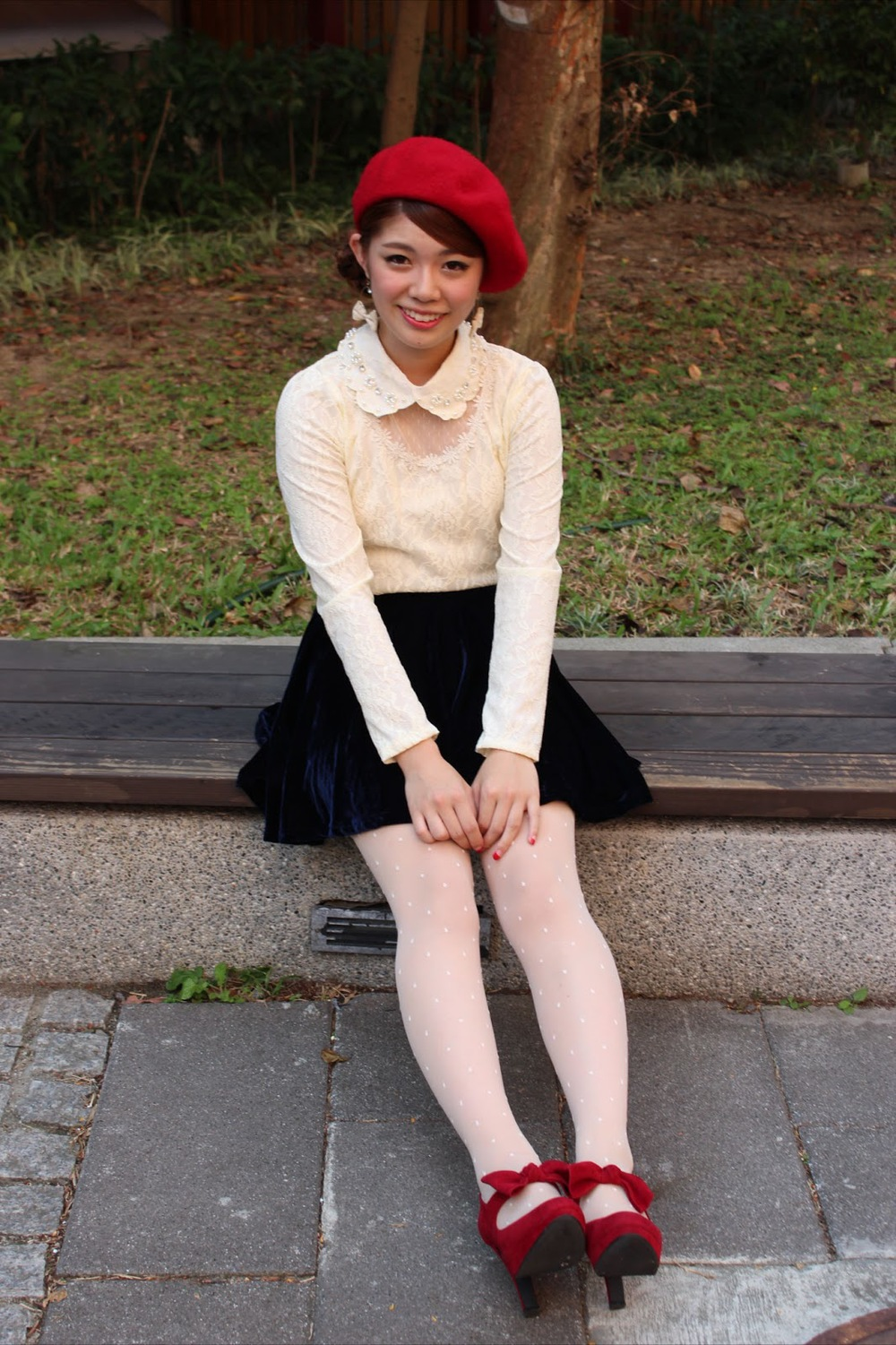 Ami a Taiwan National University Student wears a black velvet skirt with a brown belt, a white lace top and a matching red beret and bow tie heels