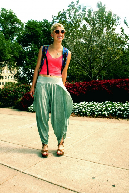 University of Kansas Student wears green Harem pants with olive platform sandals and a pink top