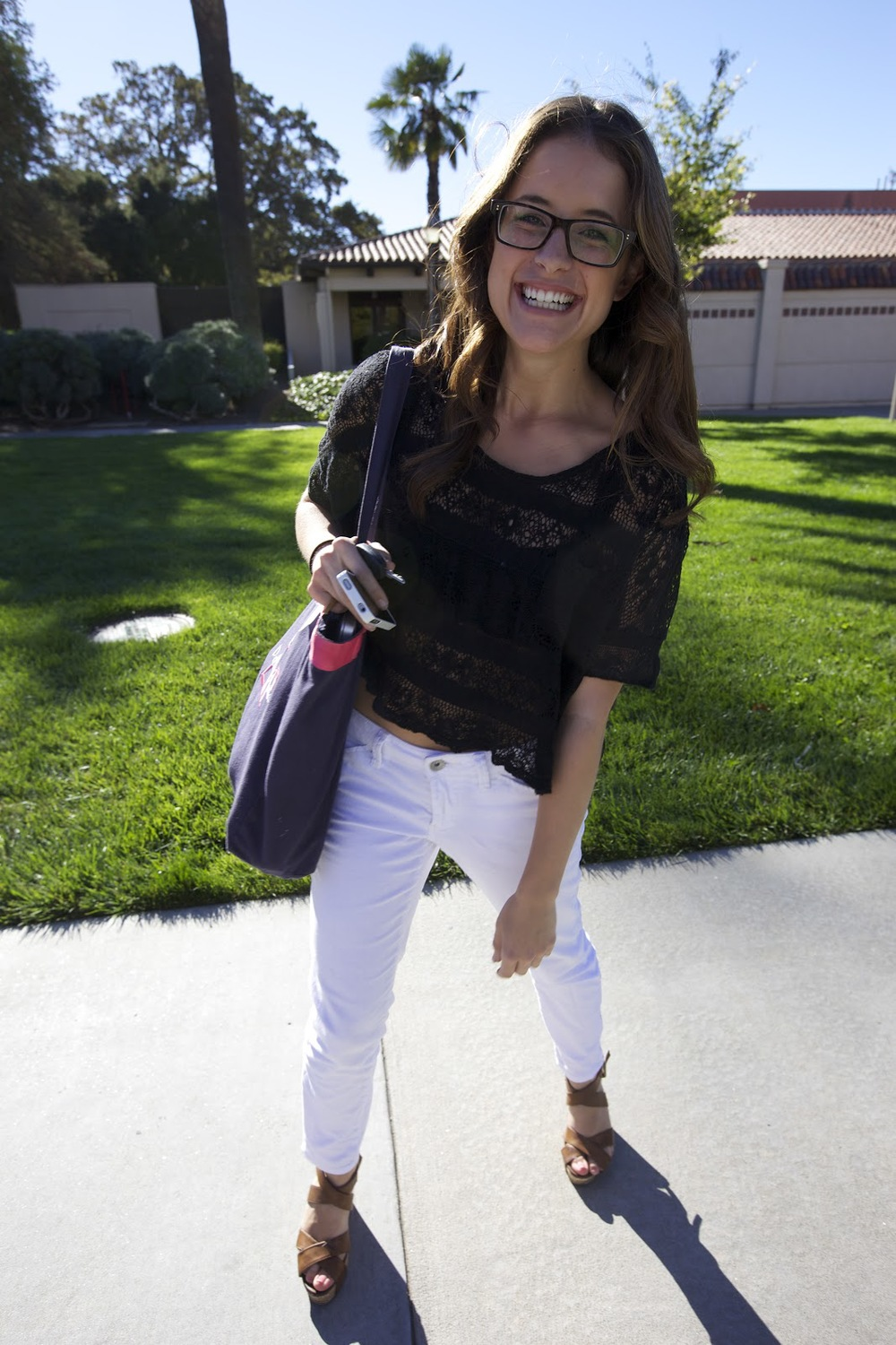 Candace a student at Santa Clara University wears a black lace top with white skinny jeans and brown platform sandal heels