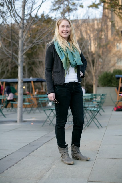 Elizabeth Kent is a Duke University senior from Pittsburg, PA majoring in Biology. She's wearing a black jacket over a white shirt paired with black jeans and dark leather sand brown coloured boots accessorized with a oversized teal scarf.