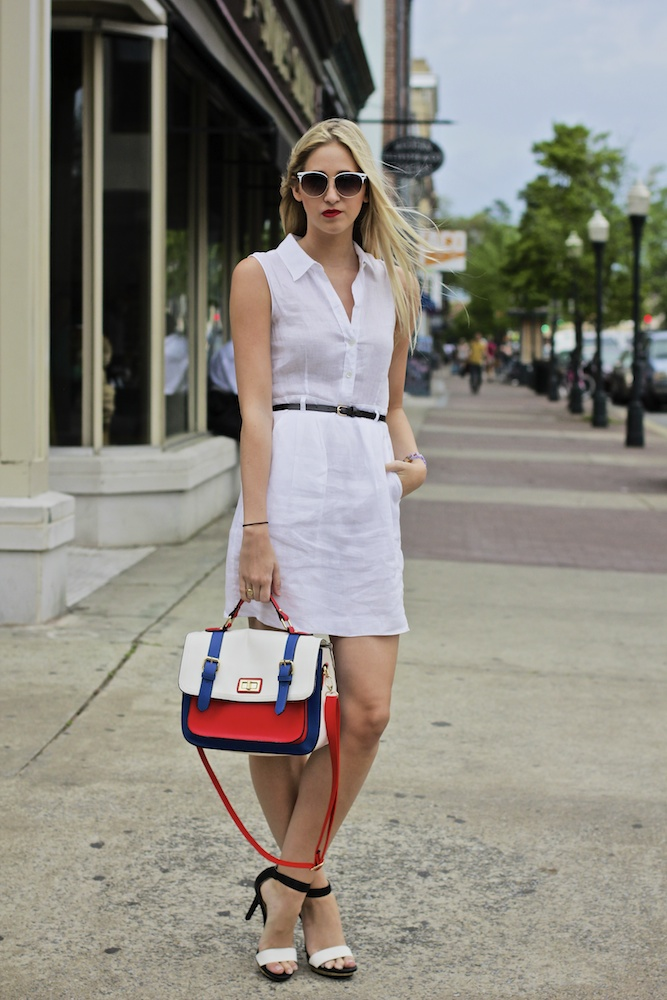 SCAD Fashion Marketing student Allison seen at SCAD Style 2013 wearing a white sleeveless dress cinched by a slim black leather belt and paired with a ankle strap black and white leather heels and a white blue and red handbag as well as silver jewelry