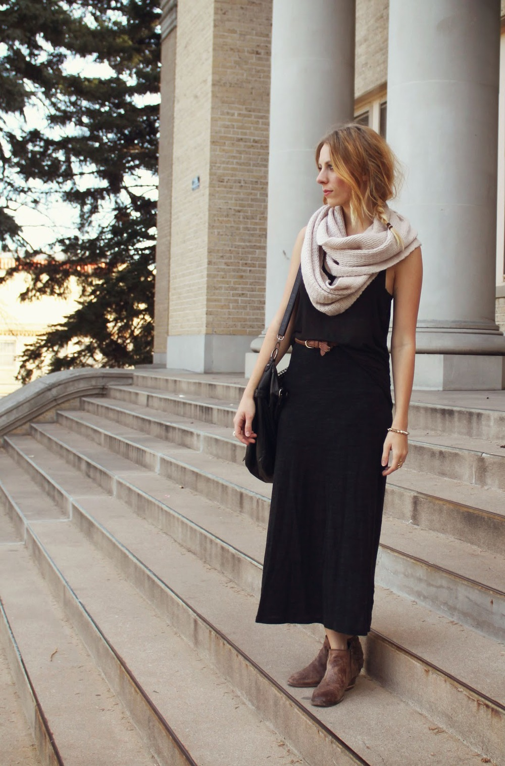 Sarah - Colorado State University student wears a dark charcoal dress anchored by a brown belt and layered with a grey cream infinity scarf and black purse and brown zip-up booties