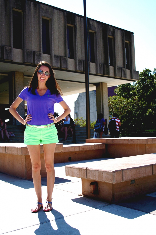 University of Kansas student wears a pair of short mint green shorts with a blue polo ralph lauren t-shirt.