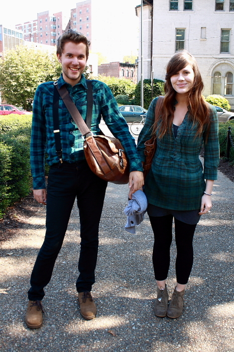 VCU male and female students wear green plaid shirts black jeans and brown suede boots.
