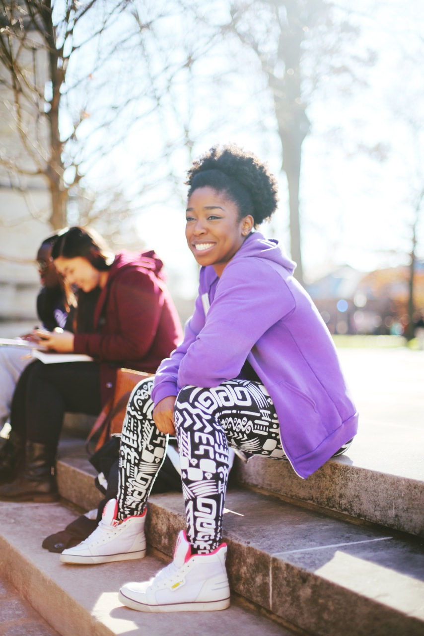 ChiChi is a student at Princeton and a Dancer in BAC ( Black Arts Company). She is wearing white high-top sneakers and print leggings.