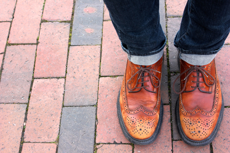 Dan L. is a philosophy graduate student at UNC Chapel Hill and he is wearing an oxford shirt with a pair of dark blue jeans and a vintage patina rich pair of brown oxford brogues.