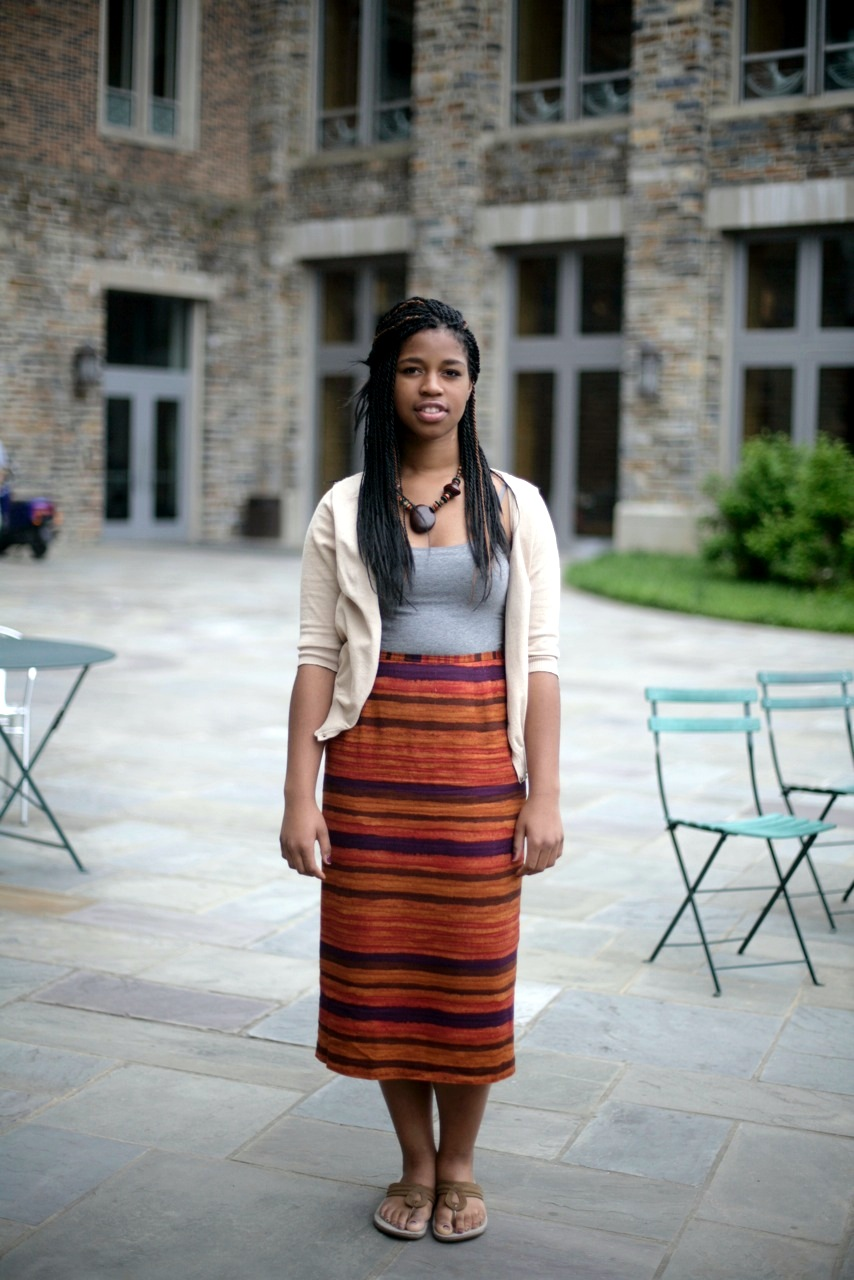 Imani Ifedi, a Duke rising junior is wearing a Bolivian mountain Andes print high waist dress, a grey top and a white lace cardigan