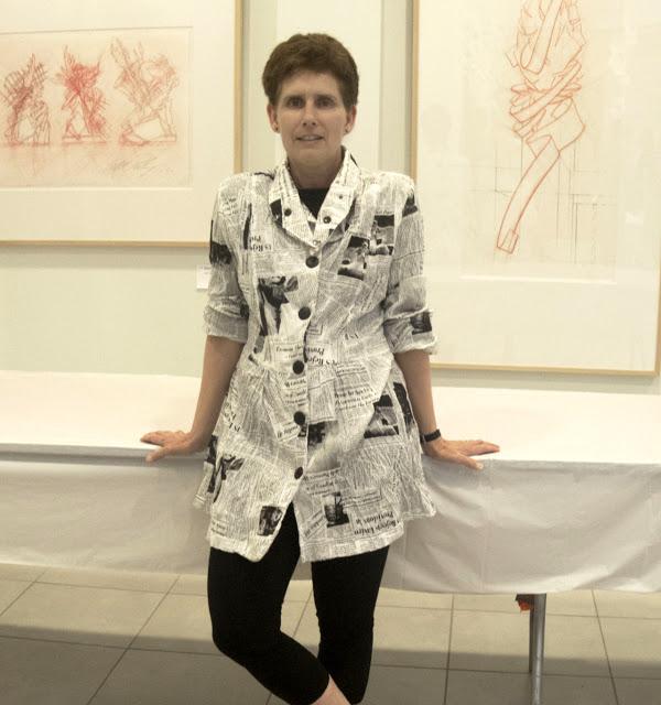 RIT Associate Professor of Design Lorrie Frear wears a newspaper print shirt