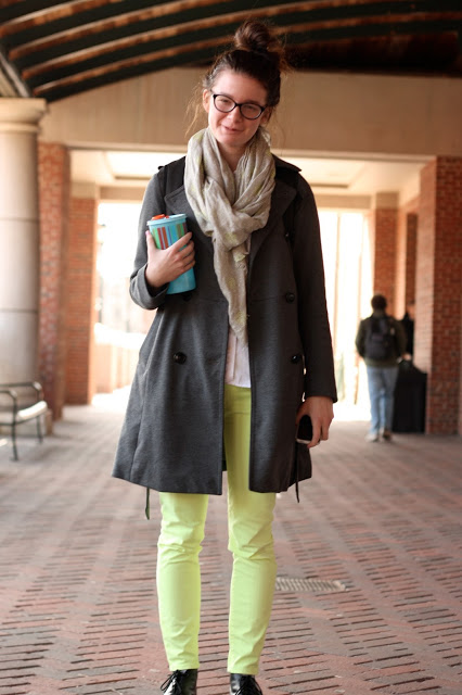 University of Georgia UGA student wears a gray rust rain jacket and a thin infinity scarf over green neon pants
