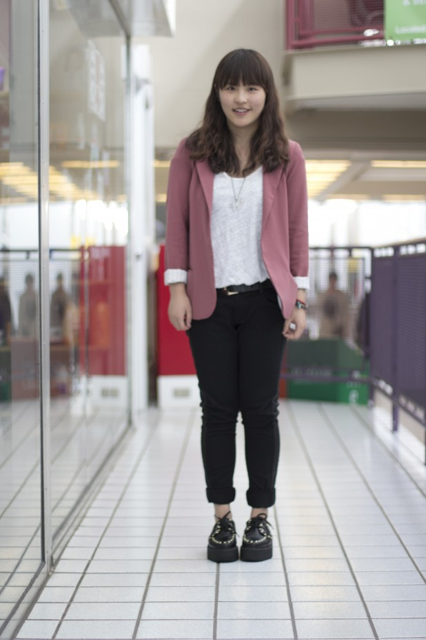 University of Alberta student wears black studded Creepers black chinos and a surprising pink purple blazer and sheer top