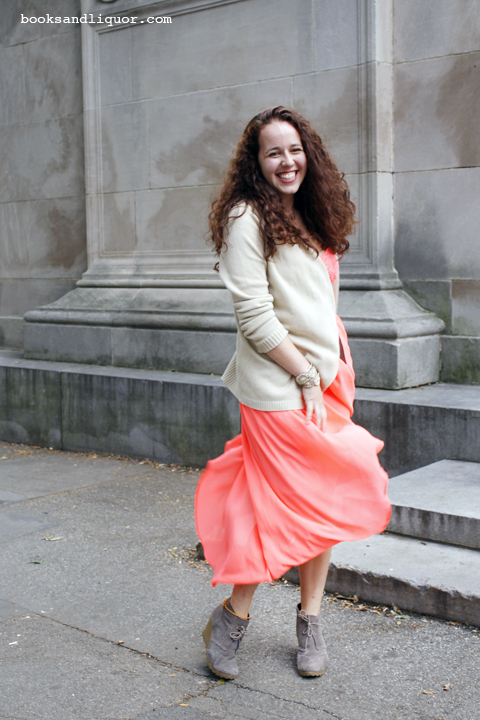 Sofie, Harvard Student wears a coral dress with grey suede bootie heels.