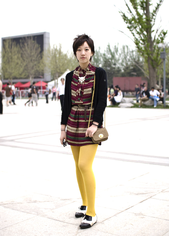 Beijing University student wears aztec print shirt with a black cardigan and black and white spectators