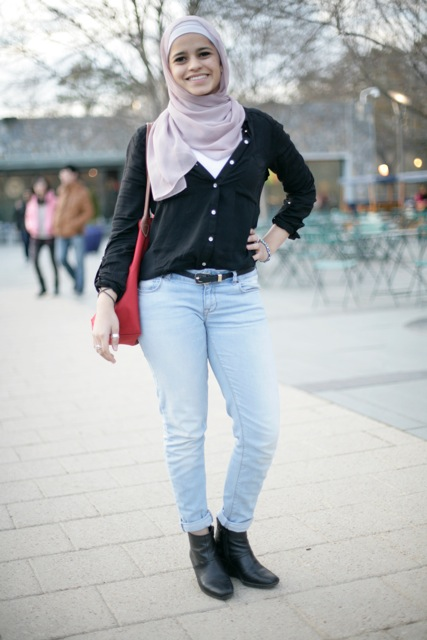 Reem Alfahad, a Duke student, wears a cute pink hijab a white shirt and a black cardigan over blue jeans black belt and black booties