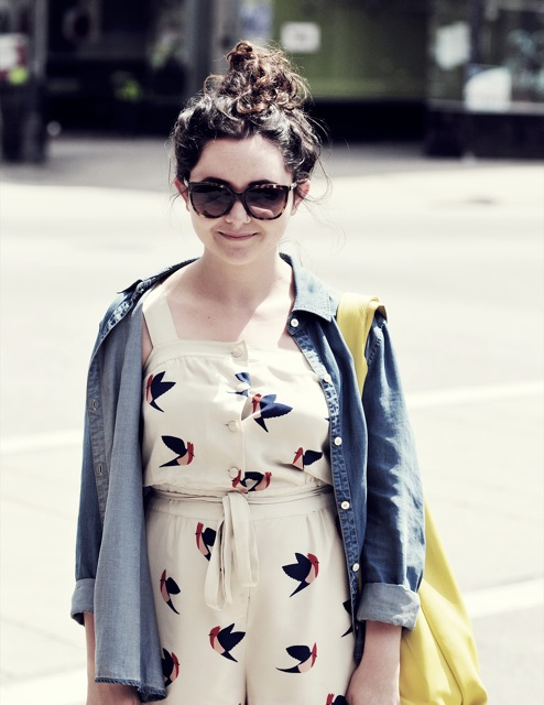 @YoureWelcomeSav SCAD student wears a flying bird print romper with a denim chambray blue shirt on top.