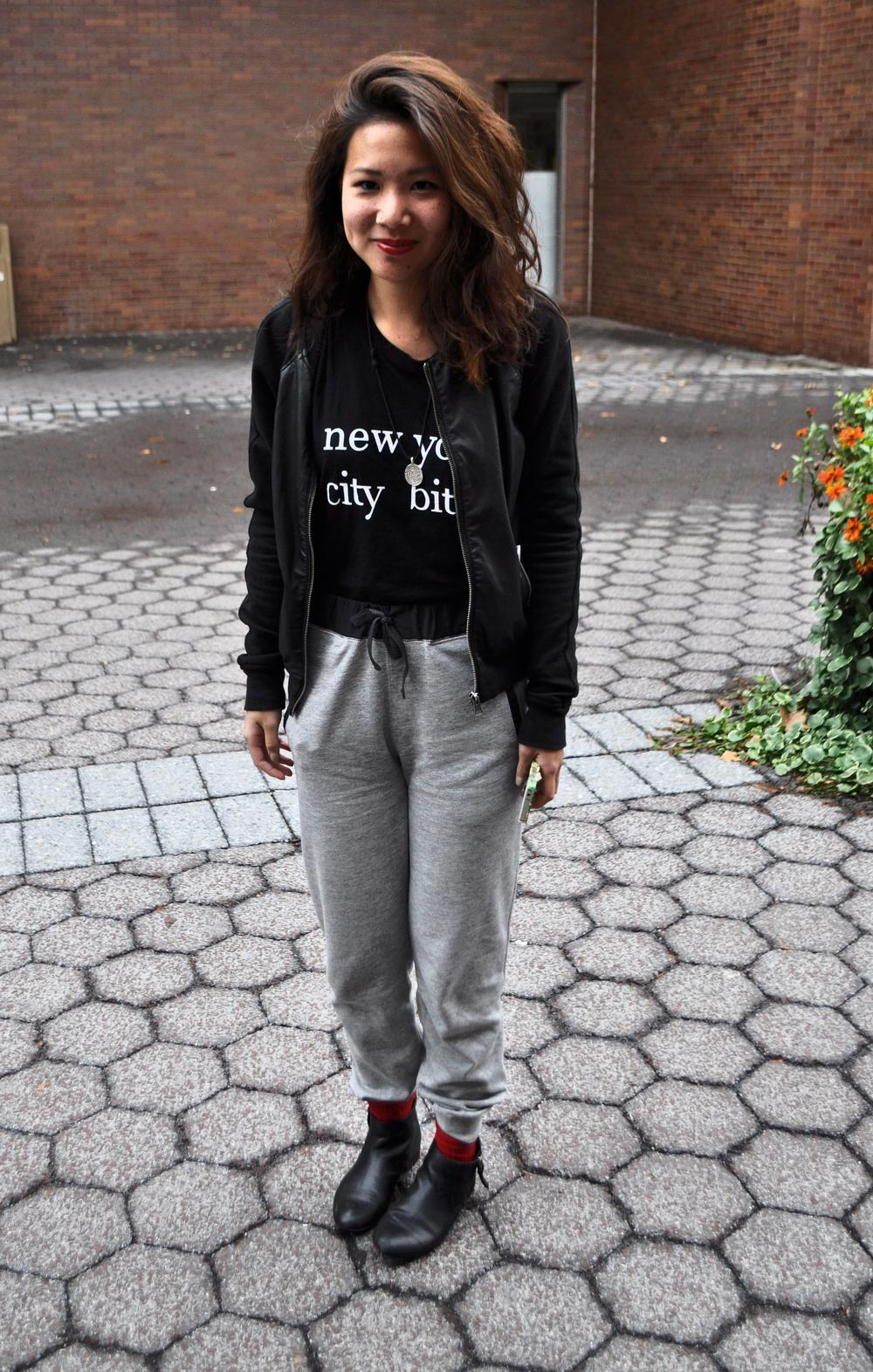 RIT student Kawah Wong wears a black leather jacket over a black new york tee t-shirt and black belted gray fleece pants