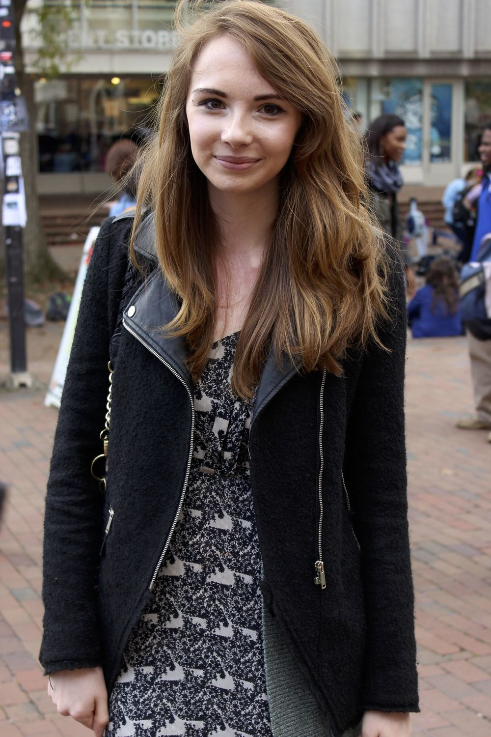 Meghan F, UNC student, Class of 2015 studying Biology and History, wears a pleather jacket over a fractal pattern dress
