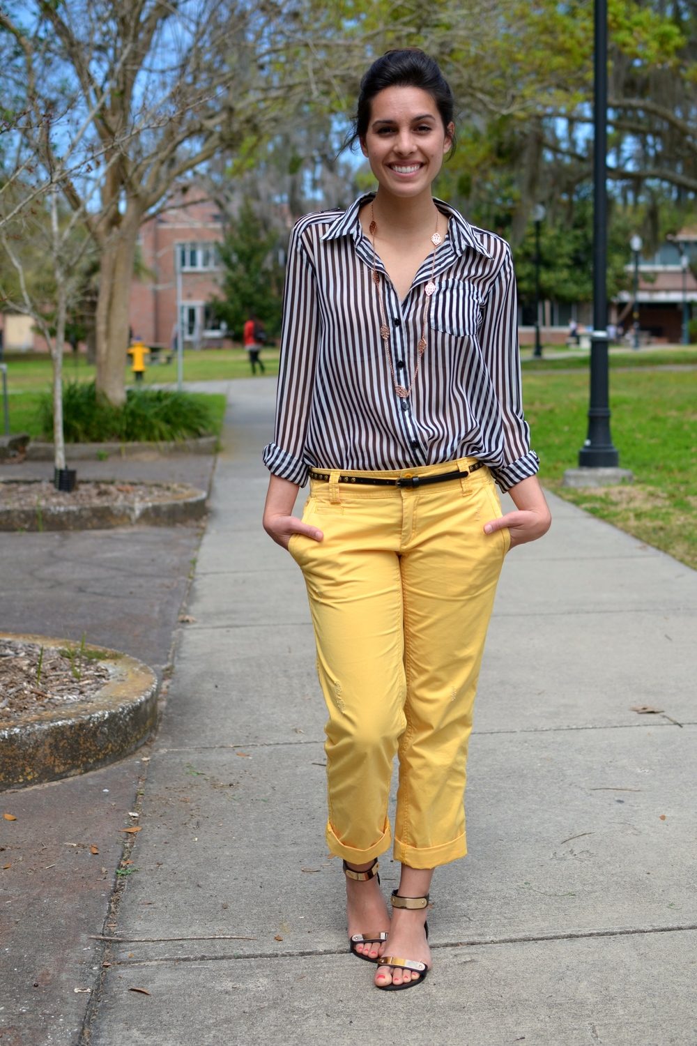 Kelsey is wearing a  Sheer Striped Blouse from Macy's  and a pair of yellow  Piped Khakis from Gap .