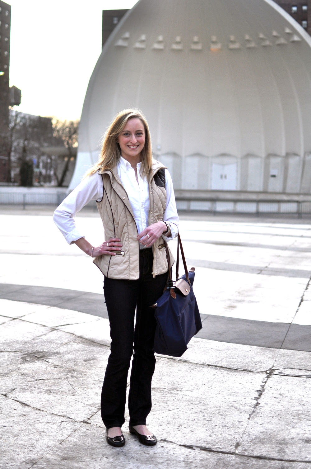 Molly | Fordham University  Taupe Quilted Vest  White Oxford Shirt  Dark Wash Jeans  Tory Burch Flats  Blue Tote Bag