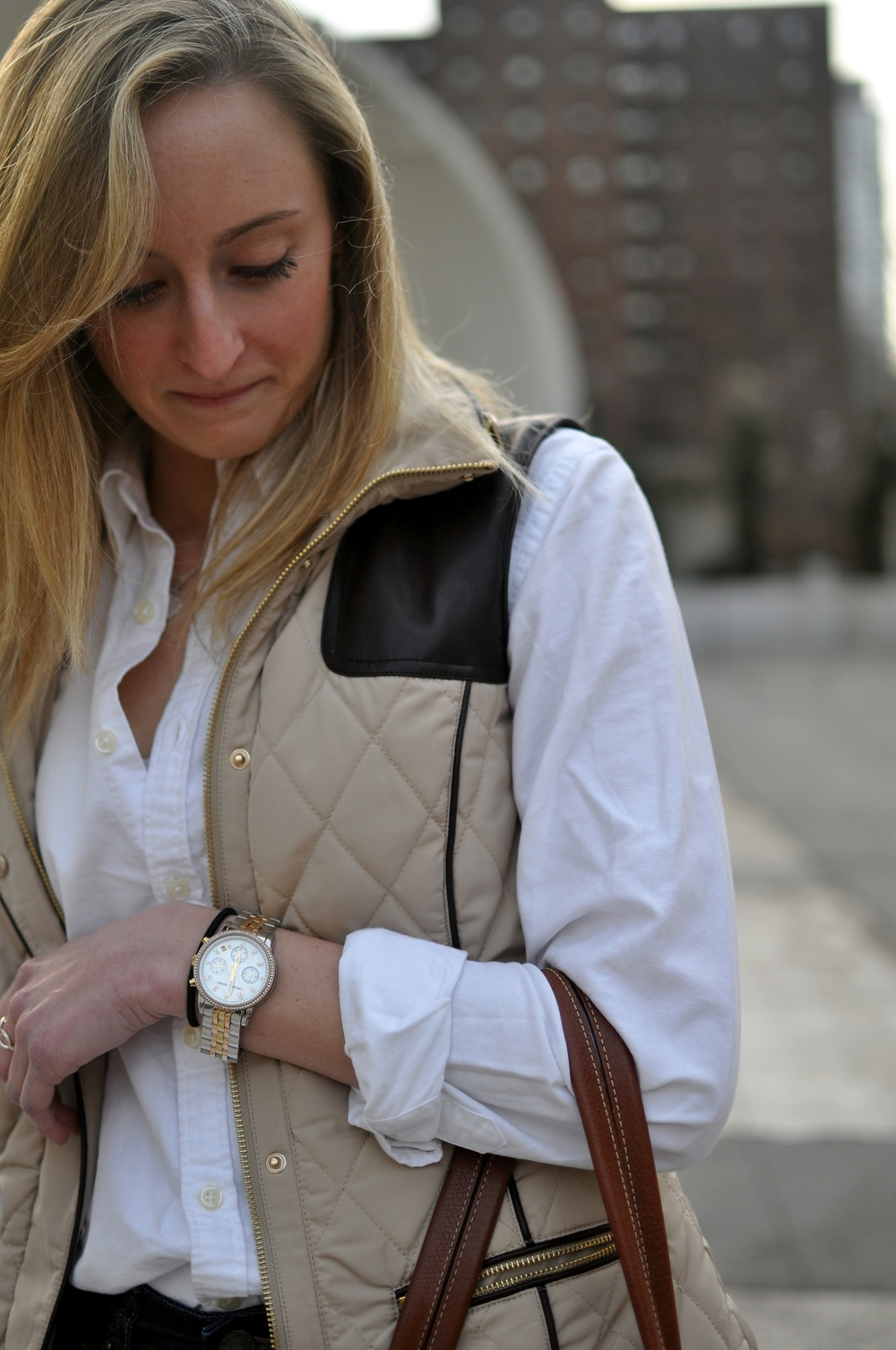 Molly | Fordham University  Taupe Quilted Vest  White Oxford Shirt   Blue Tote Bag    Gold Michael Kors Watch