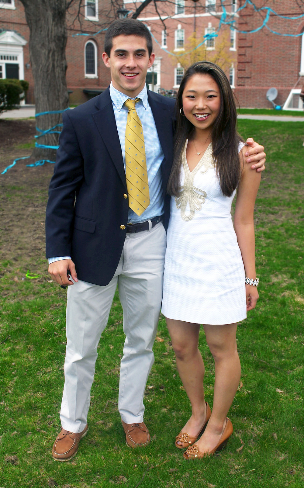 Lexi '14 | Phillips Exeter Academy  White Textured Dress with Gold Embroidered Trim  Tory Burch Peep Toe Heels in Brown/Nude     Luke '14 | Phillips Exeter Academy  Navy Blue Blazer with Gold Buttons  White & Blue Gingham Shirt  Yellow Tie with Black Repp Stripes  Khakis  Brown Boat Shoes