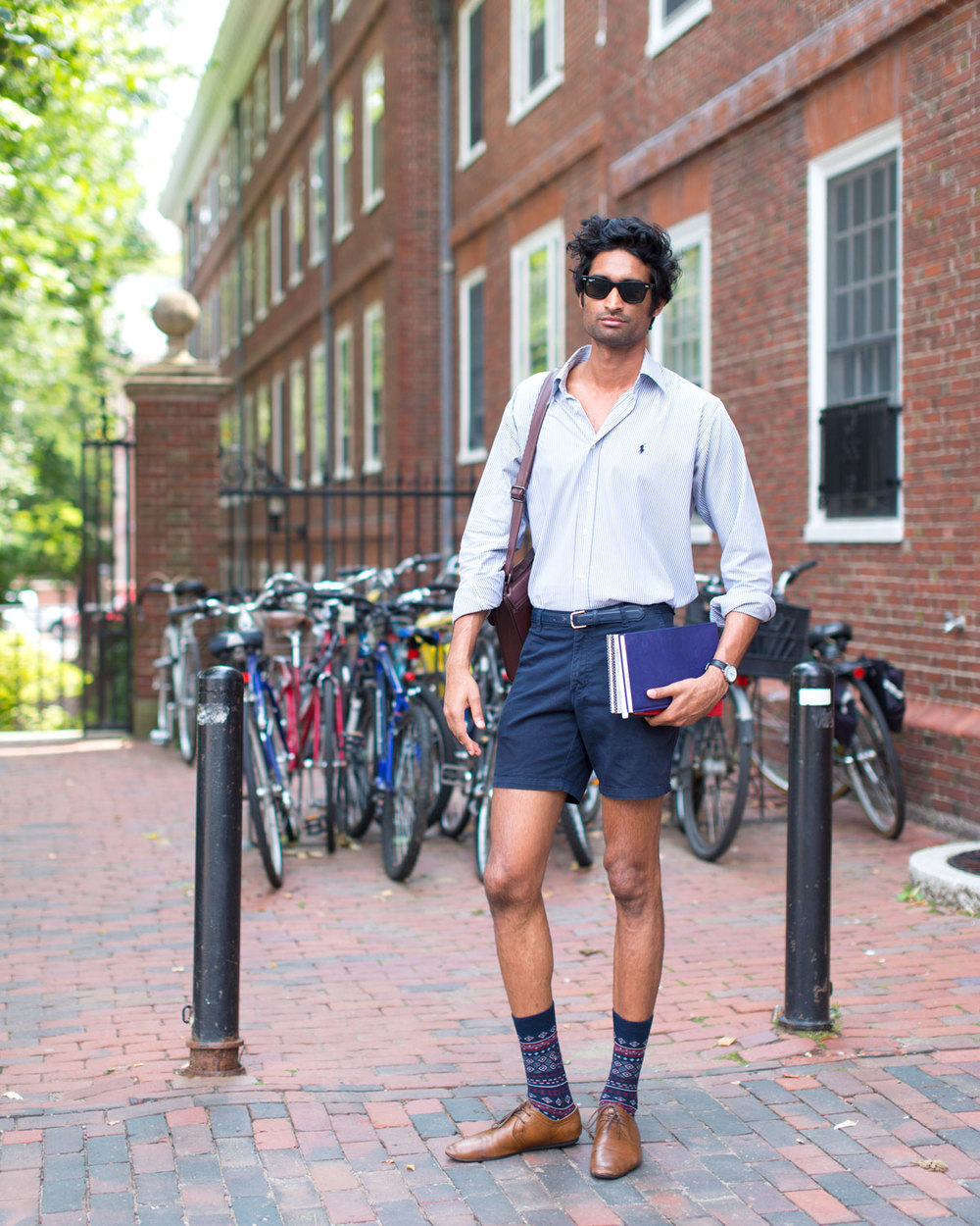 Praveen V | Harvard University | Photo by Portraits of Boston  Striped Ralph Lauren Button Down Shirt  Short Blue Shorts  Patterned Socks  Brown Oxfords