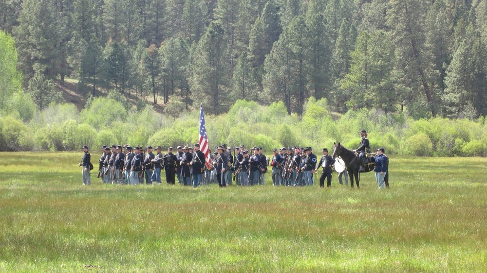 Union soldiers assembled in the meadow during one of several exercises.  Several hundred military and civilian re-enactors attend the event here at House on Metolius every year.