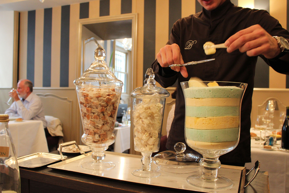Cutting marshmallow from the dessert cart at La mère Brazier in Lyon.