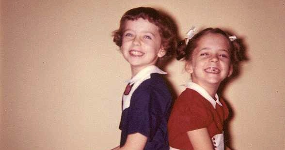 Me (left) and my sister in new dresses, circa 1950's.