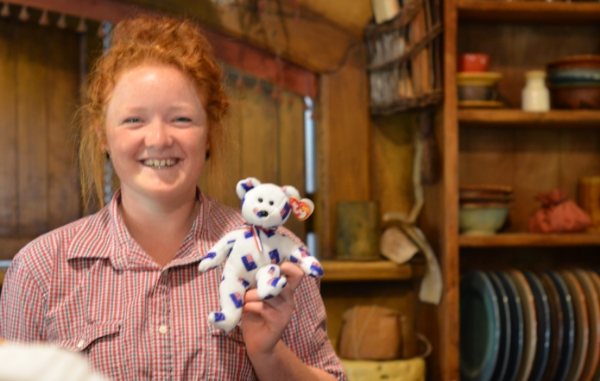 "Isn't this young woman beautiful?  She works at the Hobbiton Pub, on the set of a sheep farm where  The Hobbit  was filmed.   She is holding a gift from my sister, a New Zealand bear named ""NZ,"" who traveled with us.  More pics of him in my final post."