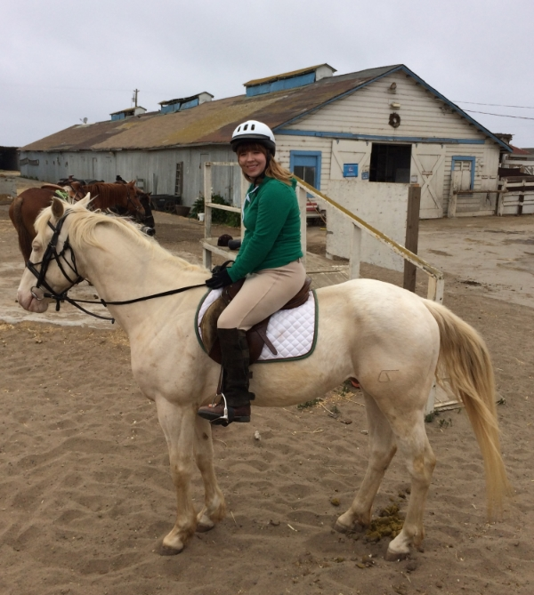 """Victoria on """"Buddy"""" -- a feisty horse that she managed to keep under control despite the steep trail."""