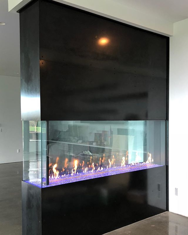 Friday and this fireplace is finish!  Thanks @misturmetals for the blackening #custom #lasercut #steelfireplace #northrupfab #fireplace #blackensteel