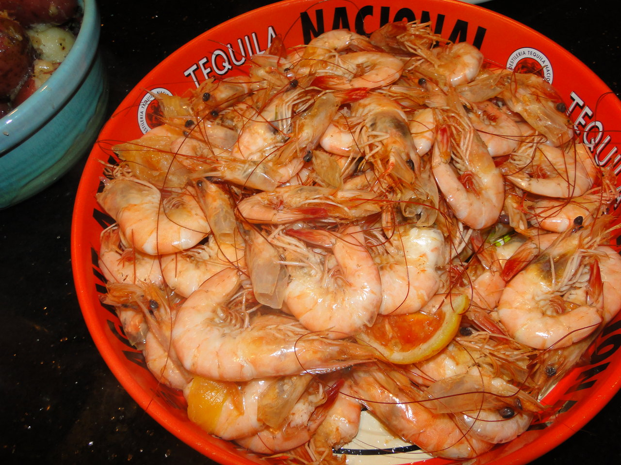 Boiled Shrimp    Thanks to Christopher Dinwiddie, these shrimp came straight from the boats in Pass Christian, MS…and they were the best ever!       2 lbs. large shrimp, shells-on and heads-on if available   1/4 cup shrimp boil seasoning, either Old Bay or Zatarains…plus more for dipping   2 lemons   1 cup cocktail sauce   1 stick butter, melted   Bring a large pot of water to a boil and add 2 Tbs. seasoning and the juice of 1 lemon. Turn the heat down to a bare simmer and add the shrimp. Cook for about 2-3 minutes or until cooked through (I always test one before draining them all) and then drain. Place in a large bowl and toss with remaining seasoning and juice of remaining lemon.   Serve with cocktail sauce, extra seasoning spice, melted butter and cold beer