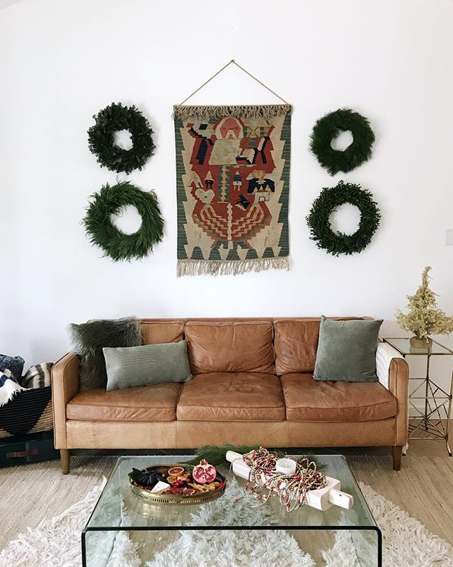I stole it from my mama | scored this Santa tapestry from my mom, and pretty sure it's going to disappear into my personal Christmas stash - because wise daughters learn great style (re: steal) from their moms. . behind the scenes shot from @hatch_house's dreamy & lush holiday shoot with @graciousgarlands. feeling all the holly jolly vibes of the holidays after this one 🎄