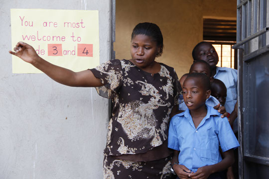 Teacher Ruth directing students
