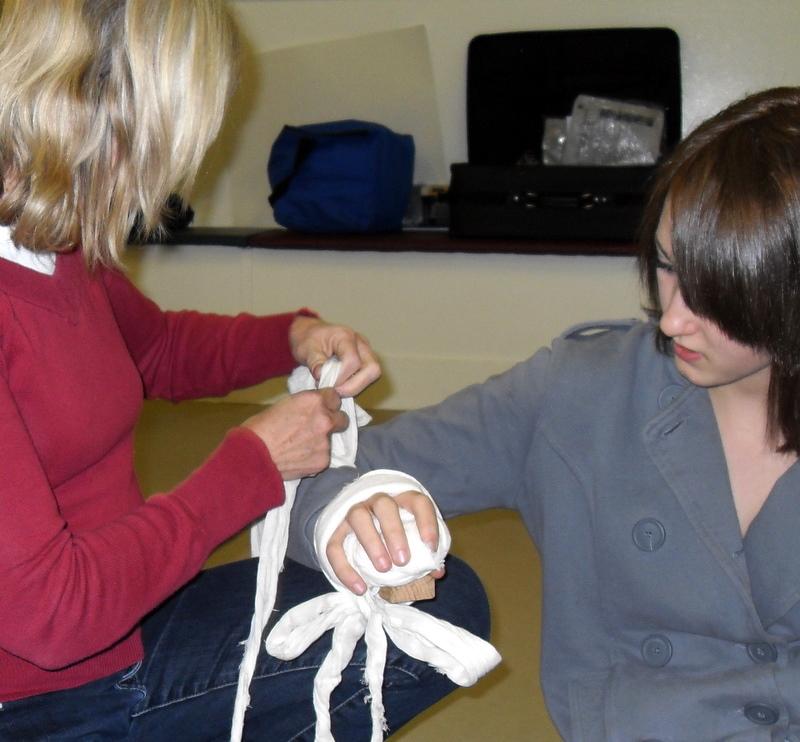 ladies bandaging hand.jpg