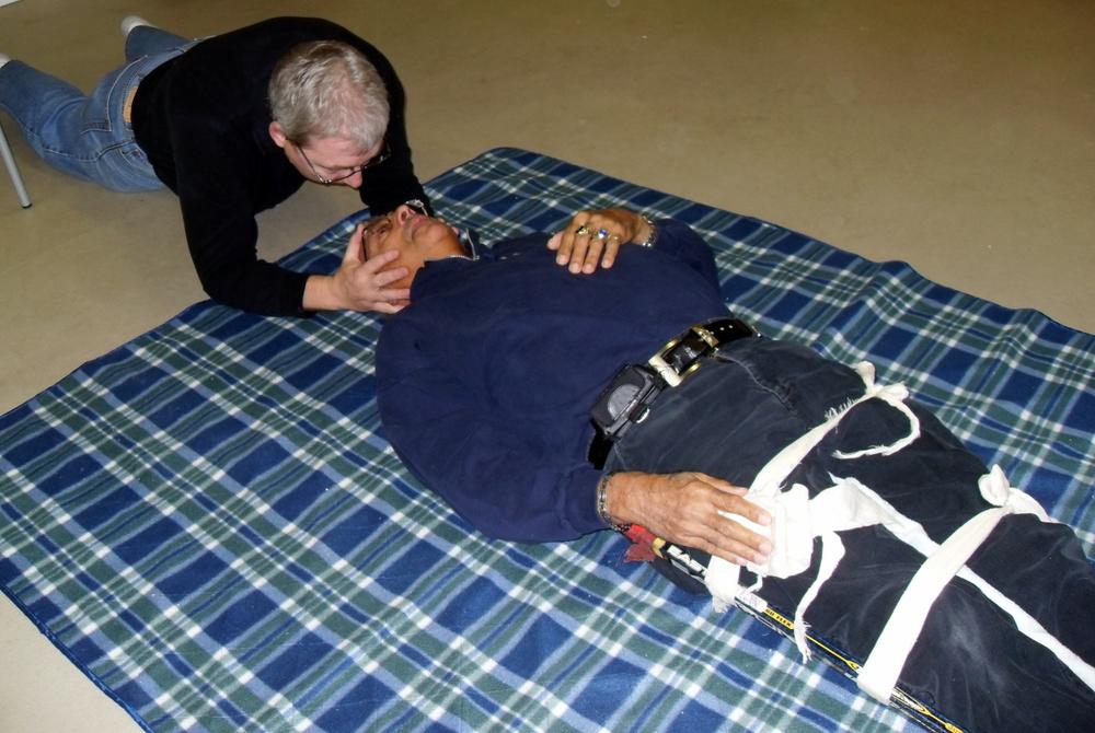 practicing first aid broken leg & spinal