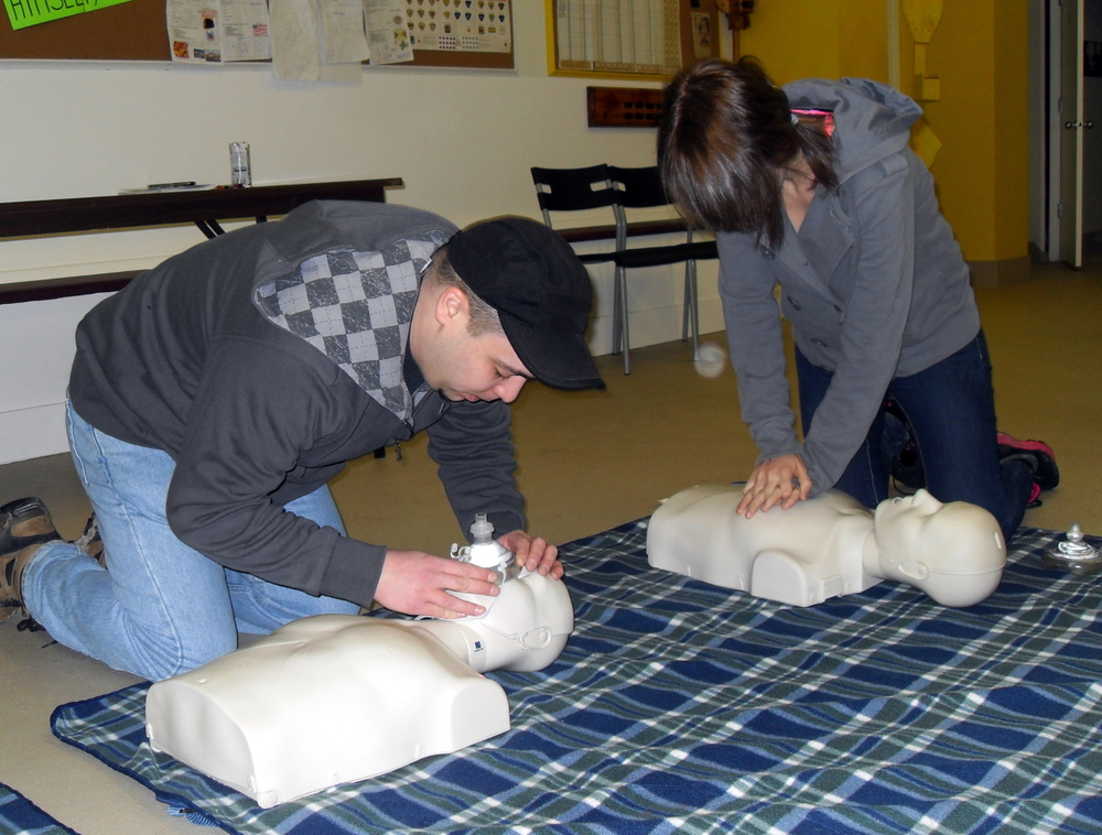 2 practicing CPR