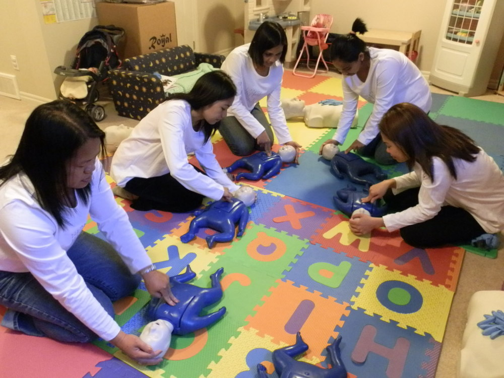 group practicing infant CPR.jpg