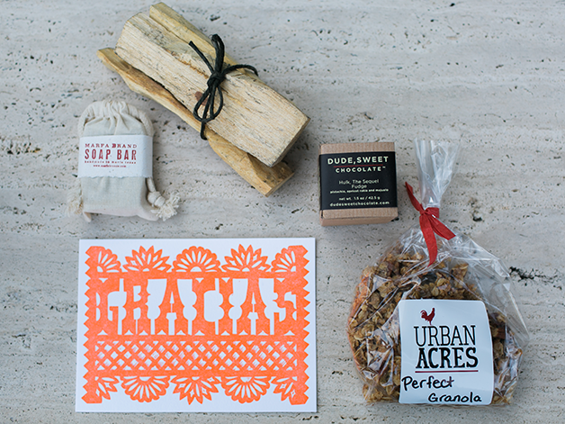 Guest party favors featuring all local products including a Lilco papel picado postcard.