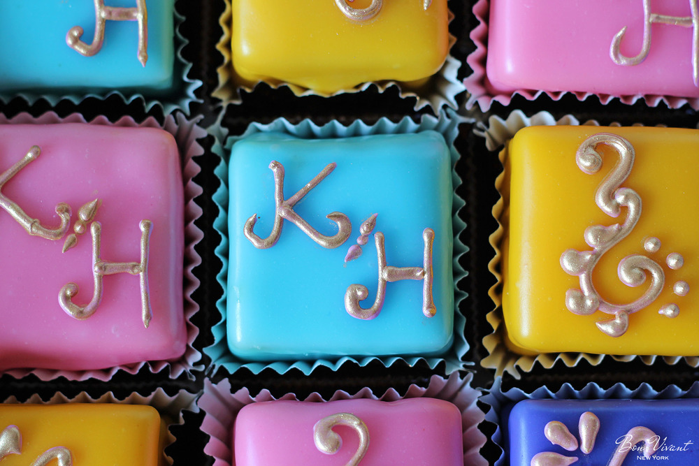 Petit cakes with gold initial piping on Turkish themed event