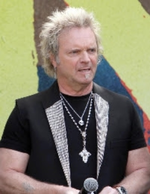 Joey Kramer of Aerosmith never takes off his D&A Rosary silver cross necklace!