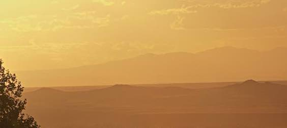 Sunset across the valley & the volcanos to Mt. Taylor.jpg