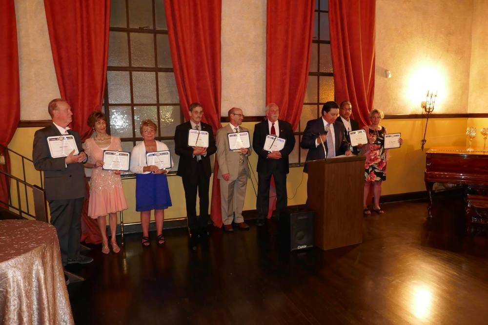Left to right: bob davies, mona davies, linda white, ken kidby, dr. mark kalkoske, bob grady, tony shin (emcee from nbc4 southern California), representative accepting for deylan kennedy, and dr. Tasha arneson.