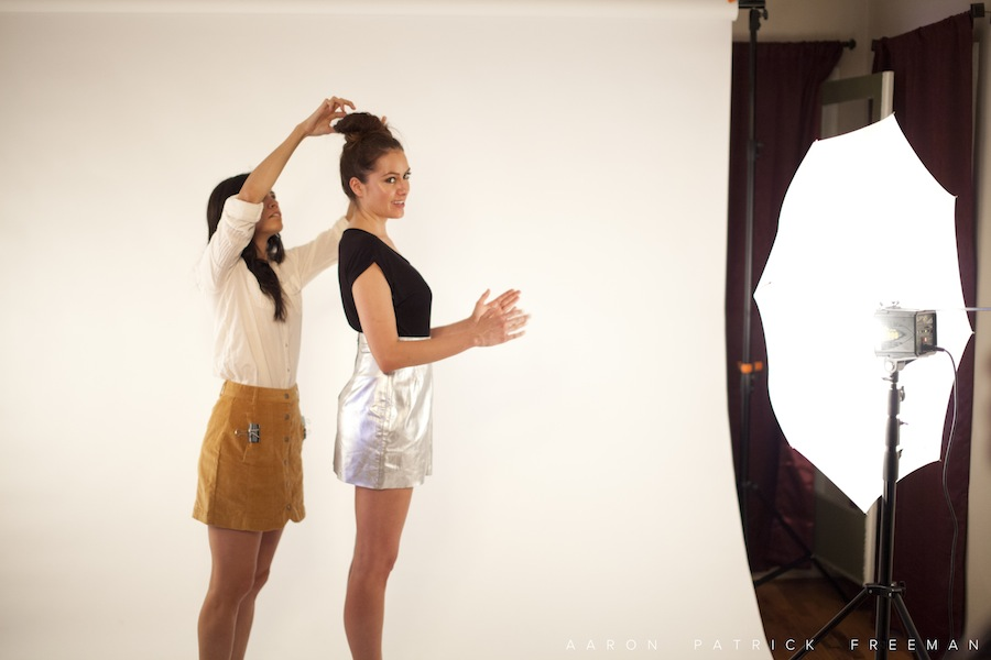 "Model and stylist prepping ""next looks""."