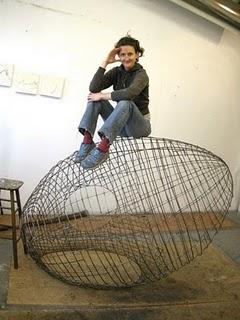 Artist Nadine Faraj strength-testing the steel skeleton of Haven