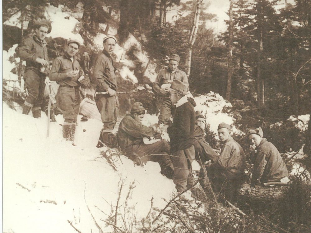 Charlie Lord, in black sweater, with his CCC crew in the winter of 1933/34 while cutting The Bruce on Mount Mansfield. The Bruce was Vermont's first purpose-cut ski trail. The man with a sandwich second from left in the back is Paul Barquin of Springfield who skied down The Bruce the day it was completed making him the first person to ski down a cut ski trail in Vermont. (Photo: From the collection of Brian Lindner)