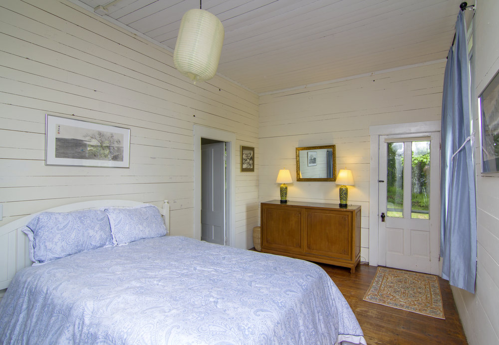 Schoolhouse Master Bedroom with a Full Bath